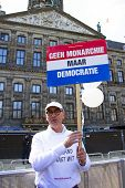 AMSTERDAM, NETHERLANDS - APRIL 30: Man demonstrating on damsquare for ' no monarchie, but democratie