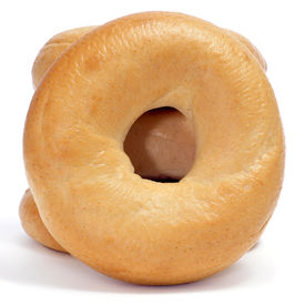 stock photo of doughy  - a pile of plain bagels on a white background - JPG