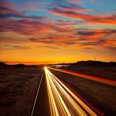 Arizona sunset at Freeway 40 with cars light traces USA