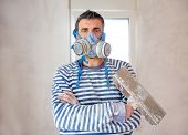 construction funny plastering man mason with protective mask and trowel in hands
