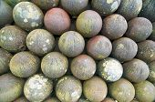 picture of cannon-ball  - Background of Cannon Bullets Piled up in an Abstract Way - JPG