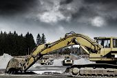image of bulldozers  - giant bulldozers in action inside gravel and sand industry - JPG