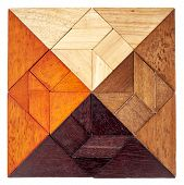 foto of tangram  - square shape created from 4 sets of wood tangram - JPG