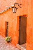 wooden door in orange hall in Santa Catalina monastery at Arequipa Peru