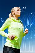 sport, fitness, exercise and lifestyle concept - woman doing running with earphones outdoors