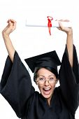 Graduating student in glasses and black academic robe puts the diploma over the head, isolated on wh