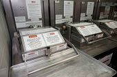 Deep fryer on restaurant kitchen, all trademarks removed