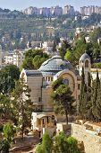 The Church  in Jerusalem. The morning sun illuminates the dome. Battlements of Jerusalem surrounded