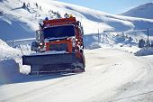 Snowplow Clearing Road