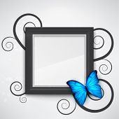 pic of blue butterfly  - Dark empty frame on the wall with a bright blue butterfly on it - JPG