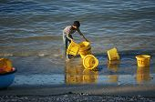 Fisherman Wash Plastic Basket On Beach