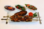 Grilled meat with eggplant and salad