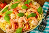 stock photo of pasta  - fresh and healthy seafood shrimps with italian spaghetti pasta - JPG