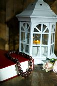 Islamic lamp, holy nook and rosary on dark background