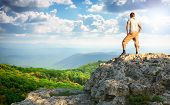 Man on top of mountain. Element of design.