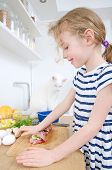 Little Girl Making Meatloaf In The Kitchen.