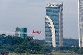 PUTRAJAYA, MALAYSIA - MAY 17, 2014: Pete Mcleod from Canada in an Edge 540 V3 plane flies through th