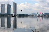 PUTRAJAYA, MALAYSIA - MAY 16, 2014: An unidentified plane from the Challenger Cup takes to the skies of Putrajaya during a training session preparing for the Red Bull Air Race World Championship 2014.