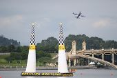 PUTRAJAYA, MALAYSIA - MAY 16, 2014: A plane from the Challenger Cup division exit the final pylons during a training session preparing for the Red Bull Air Race World Championship Putrajaya 2014.