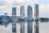PUTRAJAYA, MALAYSIA - MAY 16, 2014: Pete McLeod from Canada flying an Edge 540 v3 takes to the skies