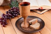 Cup of wine and bread on table close-up
