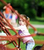 Cute Little Girl Playing Game On Child Playground