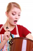 Shocked Housewife Or Chef In Kitchen Apron With Pot Of Soup Ladle