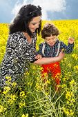 Joyful Family In Canola Field