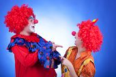 Clown Couple On Blue Background