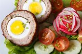 Scotch Egg On A Salad Of Tomatoes, Cucumbers And Radishes