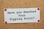 picture of time-piece  - The phrase Have You Reached Your Tipping Point typed on a piece of graph paper and pinned to a cork notice board - JPG