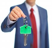 Hand with a house key.  Mortgage concept.