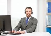 business, communication, technology and call center concept - friendly male helpline operator with h