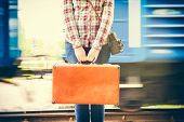 pic of wagon  - young woman with retro suitcase and camera on railway platform train wagons on background - JPG