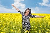 Freedom Woman In Canola Field