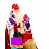 Sinterklaas with presents and old vintage telephone. isolated on white background. Dutch character of Santa Claus