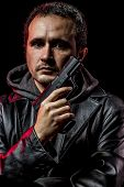 image of private detective  - Private detective with leather jacket and gun - JPG