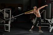 Side View Of Muscular Bodybuilder Throwing Javelin