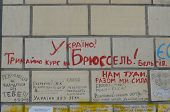 KIEV, UKRAINE - APR 19, 2014 Graffiti - Ukraine goes in Brussels and Eurounion Ukrainian Putsch of J