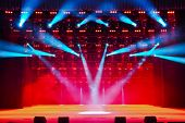 stock photo of soffit  - Illuminated empty theater stage with smoke and rays of light - JPG