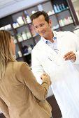 Veterinarian giving handshake to client