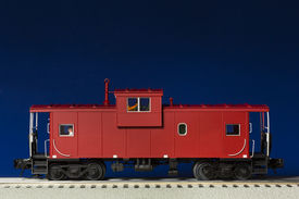 image of caboose  - A red model railroad caboose on a track - JPG