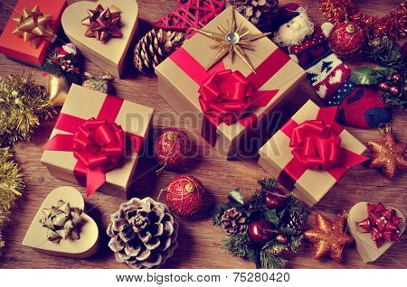 A Pile Of Gifts And Christmas Ornaments Such As Balls Stars Tinsel