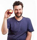 Bearded Caucasian Man Holding An Apple
