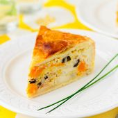 stock photo of kalamata olives  - A Piece of Greek Rice Pumpkin Kalamata Olive and Feta Pie square copy space for your text  - JPG