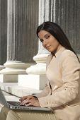 pretty businesswoman typing laptop