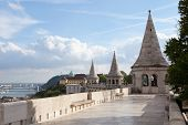 BUDAPEST, HUNGARY - SEPT 21 2014 : The towers of the Fisherman's Bastion overlook the river Danube.