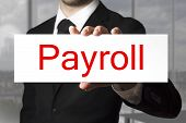 Businessman Holding Sign Payroll