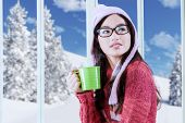 Girl In Winter Clothes Drinking Hot Beverage
