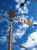 stock photo of wispy  - Columbia Lightship Main Light with Nautical Flags Hanging with Wispy Clouds - JPG